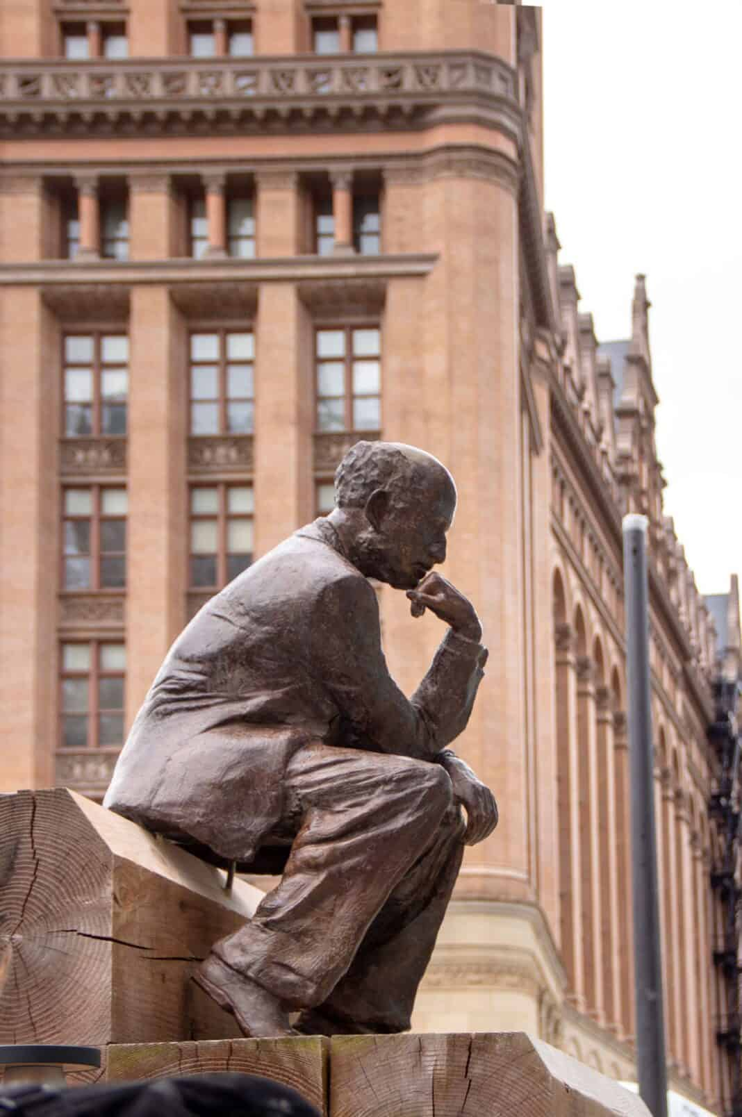 Pensive statue in the BMO Tower plaza. Photo courtesy of Amanda Marek/Irgens Partners