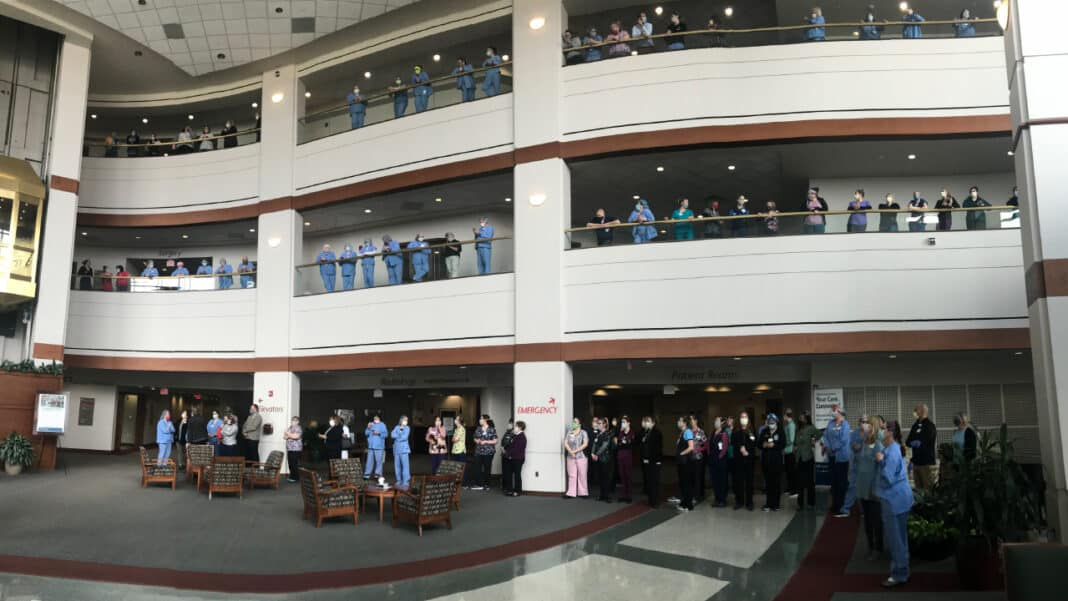 Employees of Aurora Medical Center in Grafton gather to send off Wynonia Page, an 81-year-old COVID-19 patient who was recently discharged from the hospital.