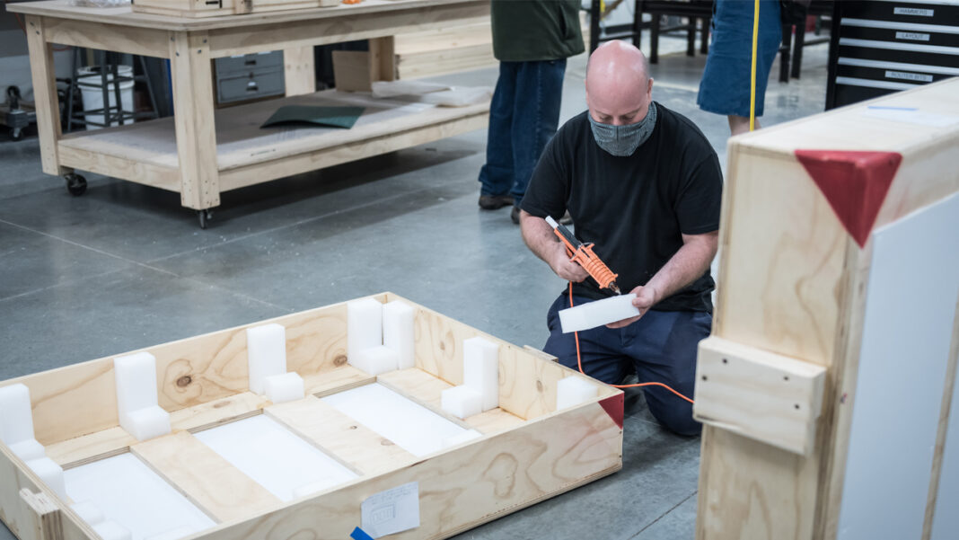 Leonard Cicero assembles a crate that is specially tailored to fit a piece of artwork that will be shipped from Guardian's facility.