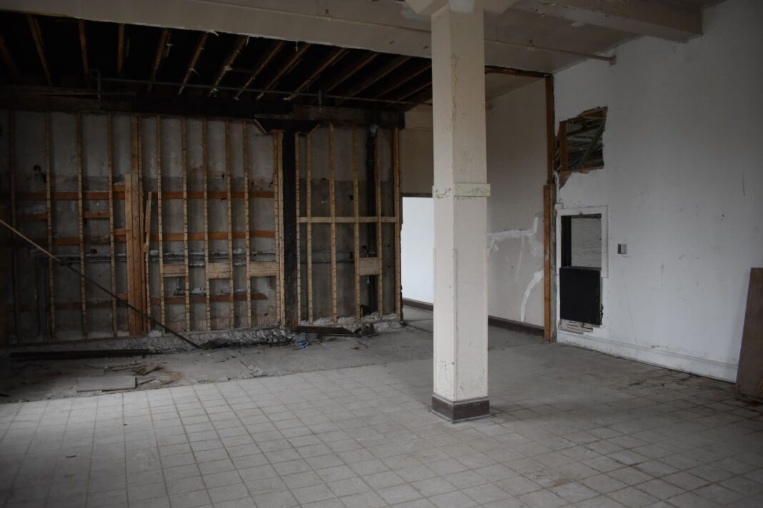 The third floor is where the museum will keep its offices. During demolition, evidence of a fire was discovered in some charred boards and columns.