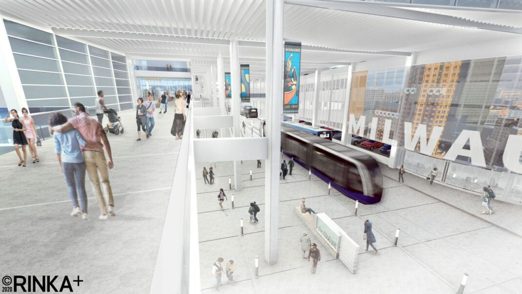 View of the ground level transit concourse from the second floor concourse showing the large format LED screen. Rendering: Rinka