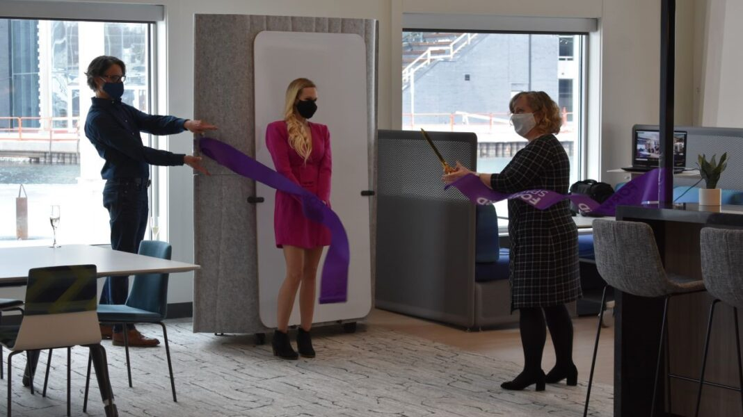 Forward Space CEO Jenny Niemann cuts the ribbon on its new showroom in Milwaukee's Harbor District