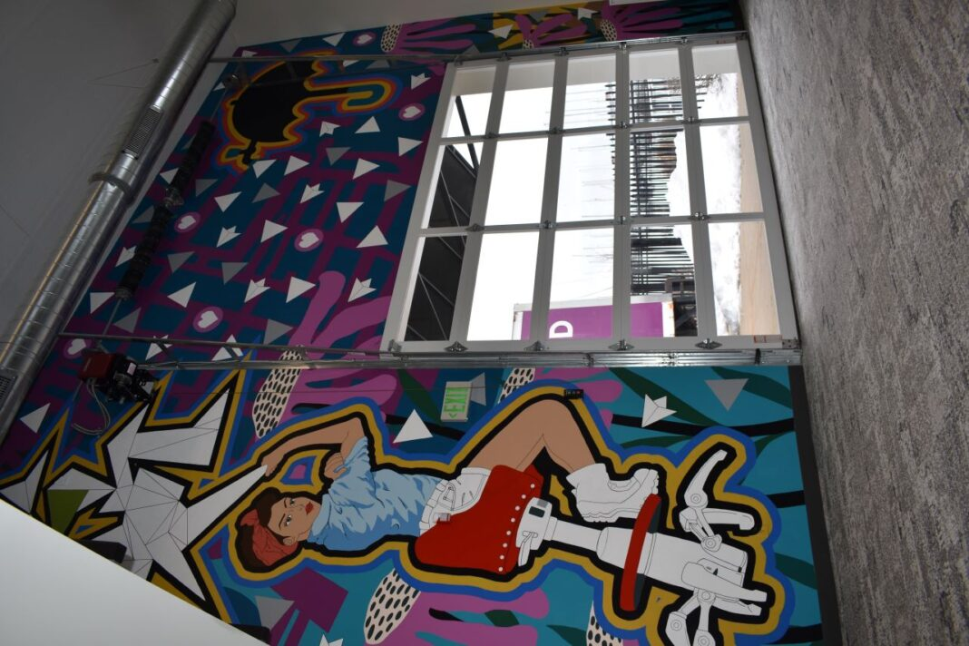 Forward Space has a custom painted mural on its north wall, painted by Byada Meredith, a muralist contracted through Wallpapered City