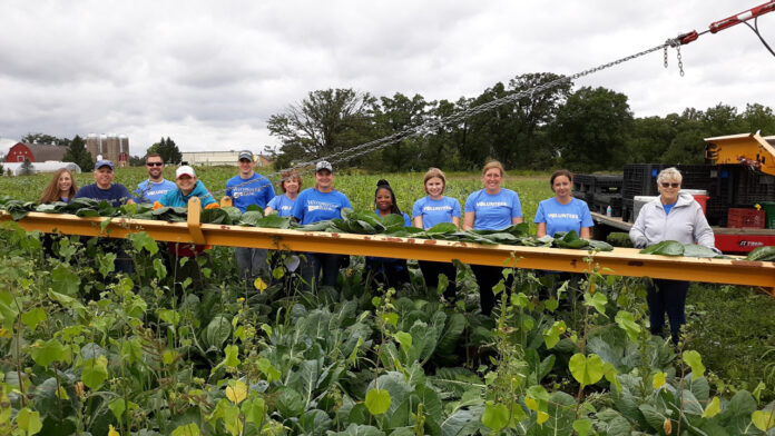 WaterStone Bank staff volunteers at the farm