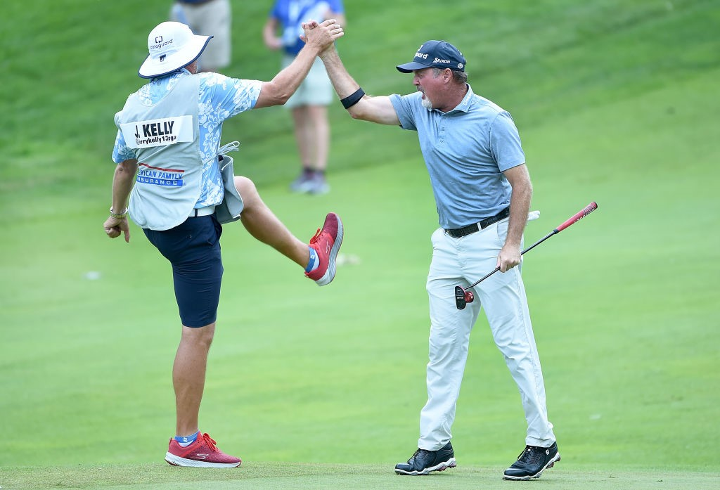 Jerry Kelly and his caddie celebrate Kelly's victory in the 2019 American Family Insurance Championship at University Ridge in Madison.