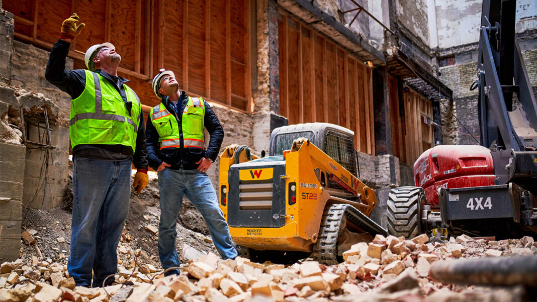 Construction workers at the Bradley Symphony Center project site.