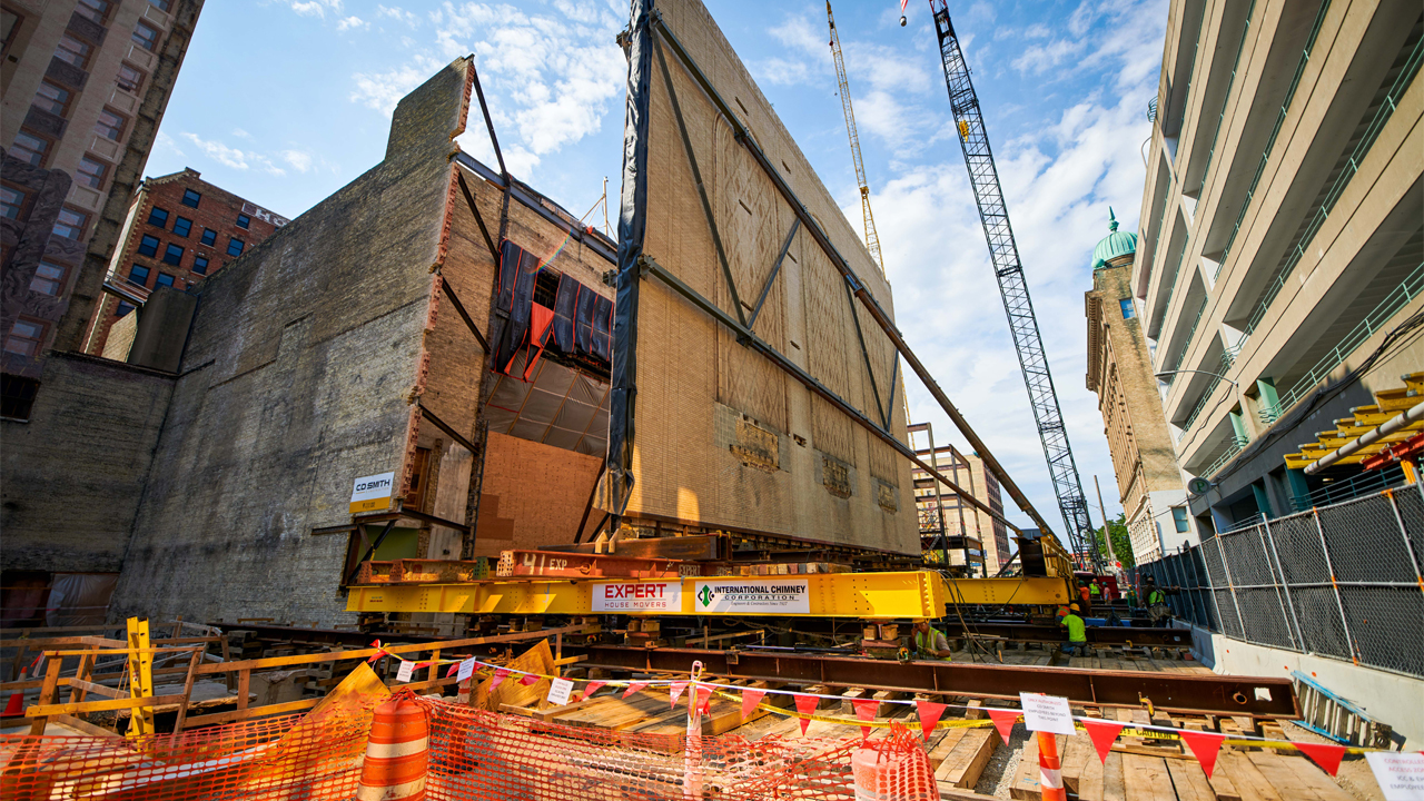 An exterior wall of the Warner Grand Theatre was moved 35 feet into Second Street to add enough space for the symphony.