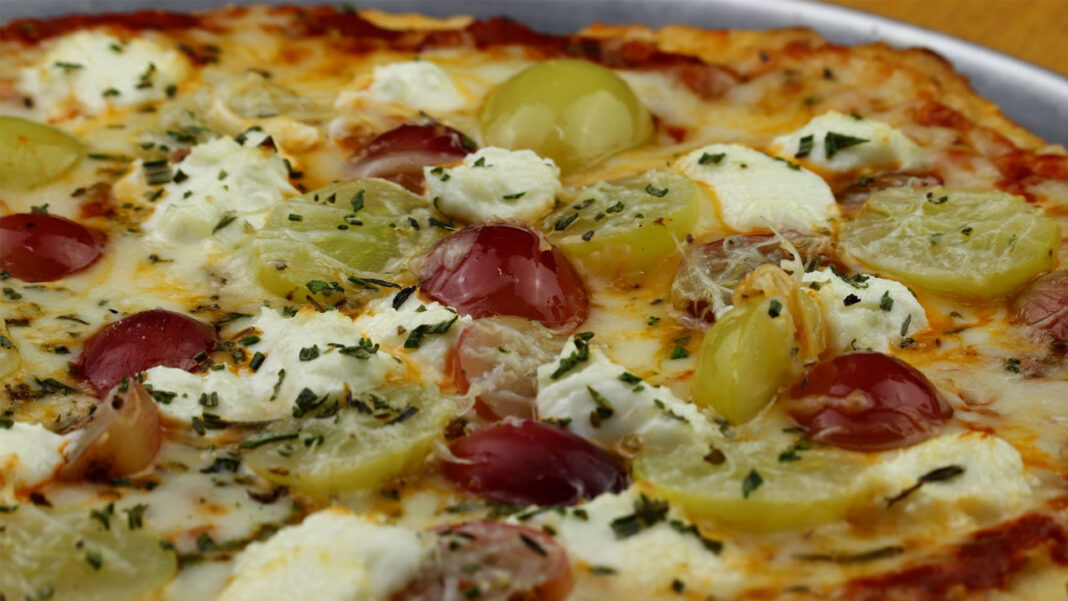 """Chef Erik Mahr's new artisan pizzas have become top sellers for both lunch and dinner. The """"Vine"""" is topped with roasted grapes, fresh rosemary, ricotta, pecorino Romano and mozzarella."""