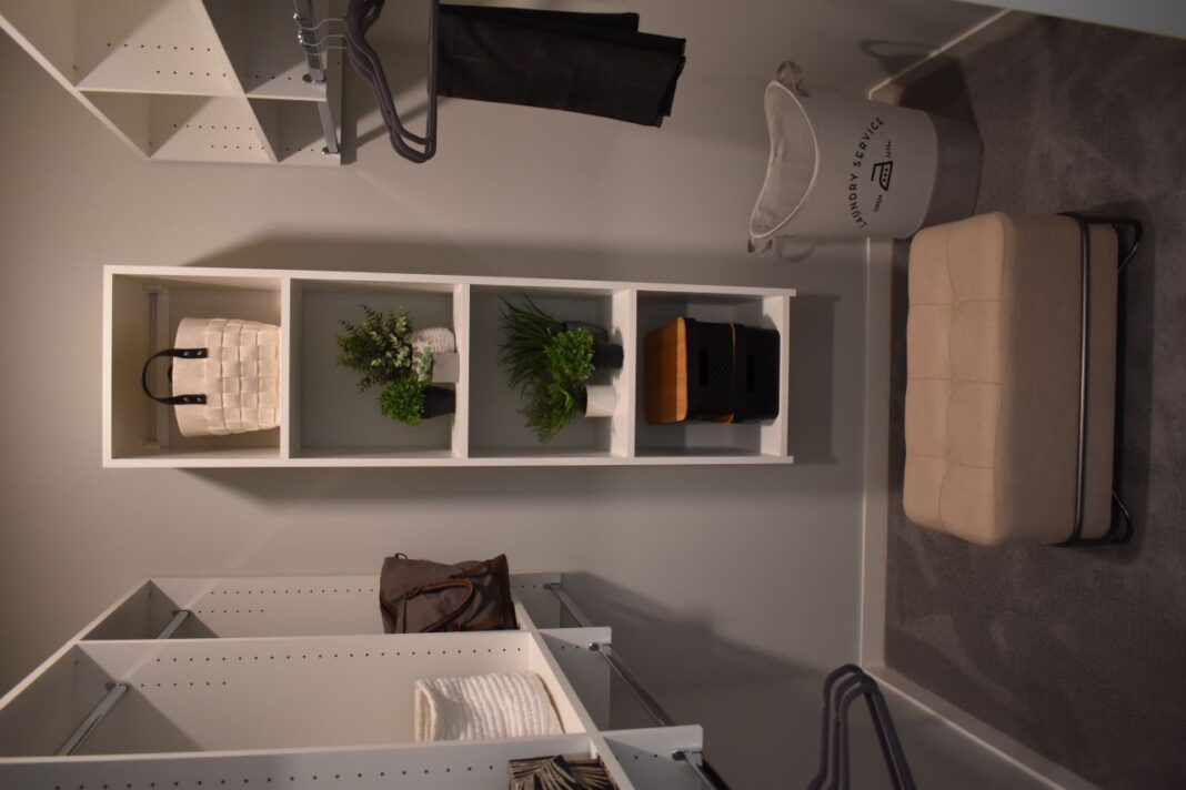 The closets are equipped with wooden shelving