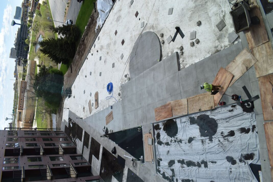 The courtyard area is under construction. It will include gathering space and a dog run, among other amenities.