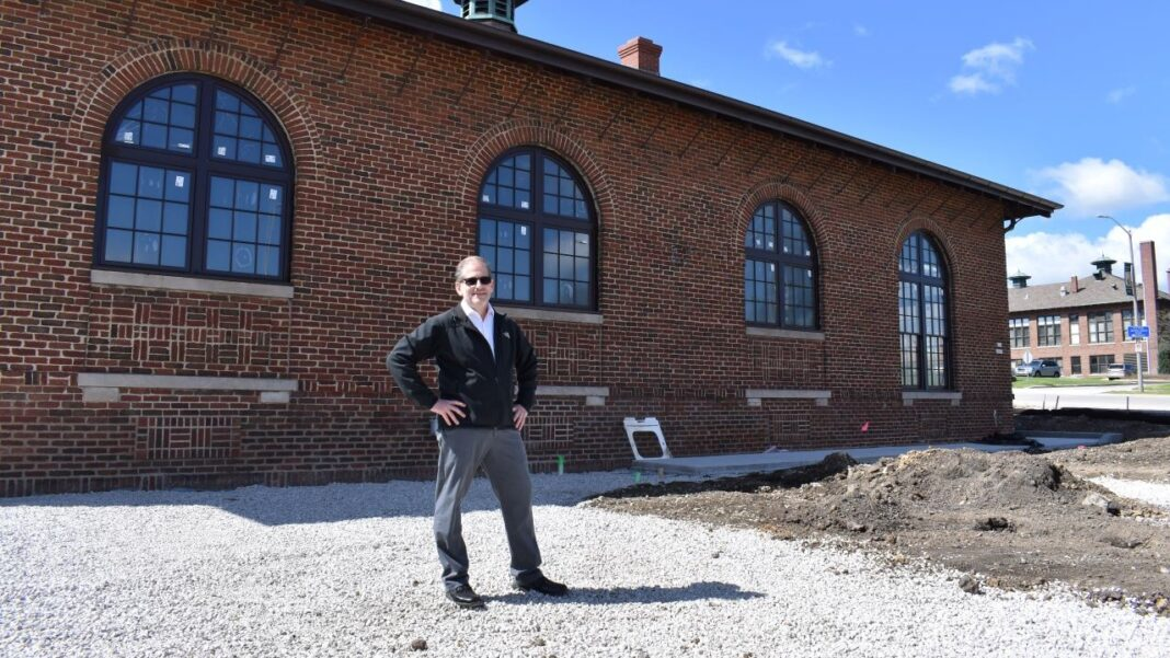 Rodney Zimmerman of Ally's Bistro standing where the future outdoor terrace will be.