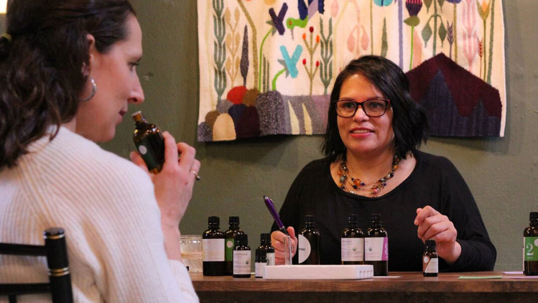 Monica Semington, owner of Monash Natural Blends, works with a client.