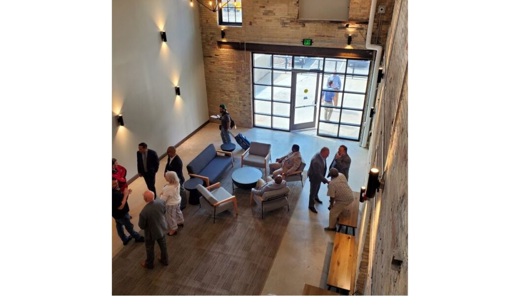 People gathering for the Arabella ribbon cutting.