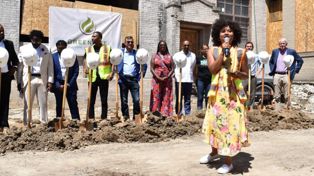 Nyesha Stone, founder of Carvd N Stone, speaks just before the ceremonial turning of dirt.
