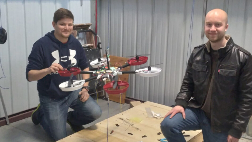 GLW Technologies mechanical engineer Mitch Dyrdahl and co-founder Andy Klinge prepare the X6-02 drone for indoor flight inside the Janesville Innovation Center.