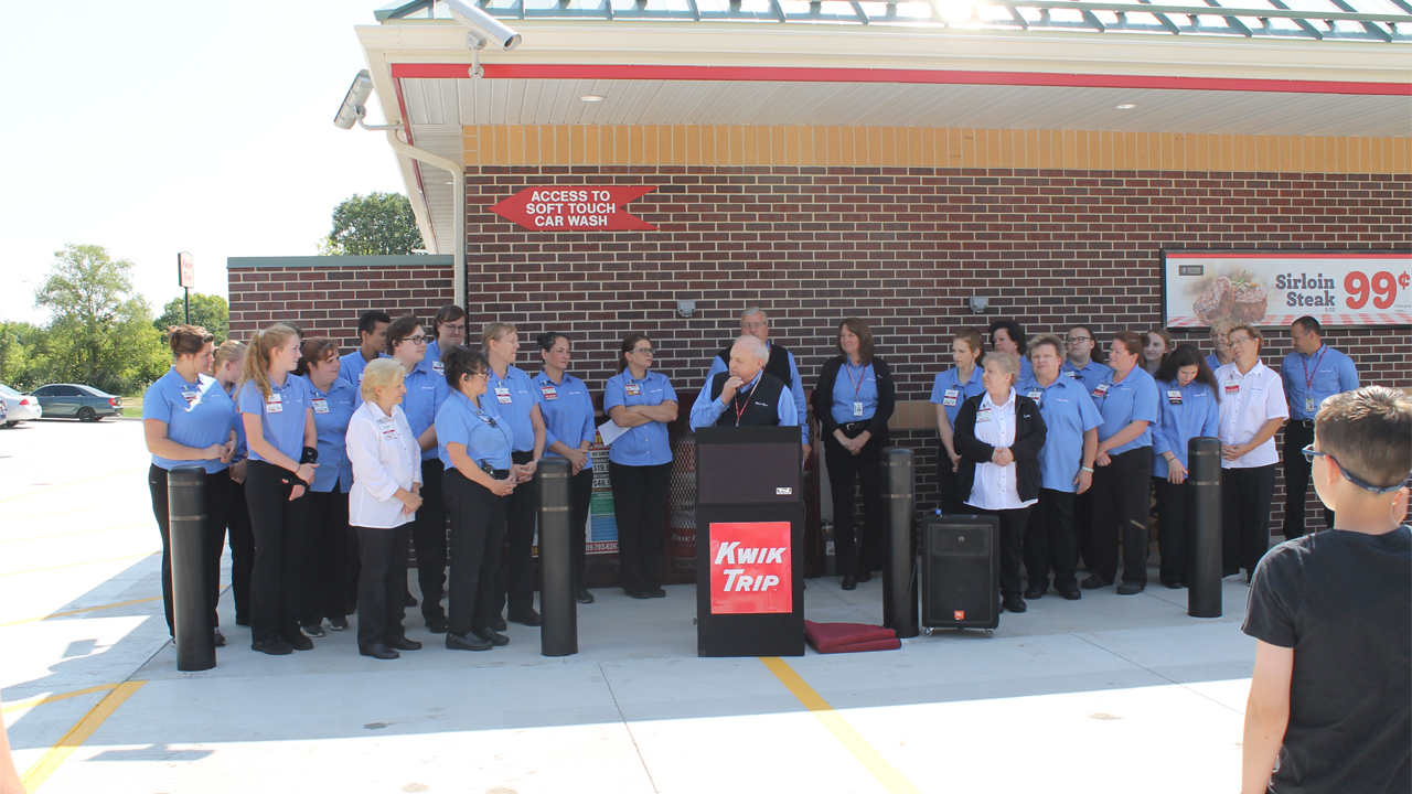 Kwik Trip founder and CEO Don Zietlow pictured with employees at the celebration of a store opening.