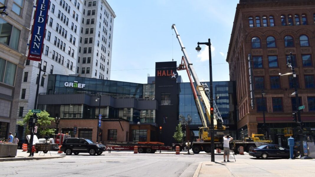 3rd Street Market Hall sign being installed at The Avenue.