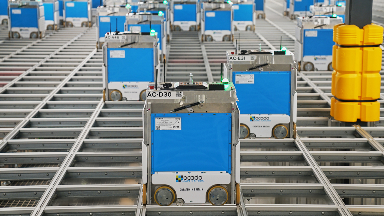 Bots on a grid at one of Kroger's new automated customer fulfillment centers.