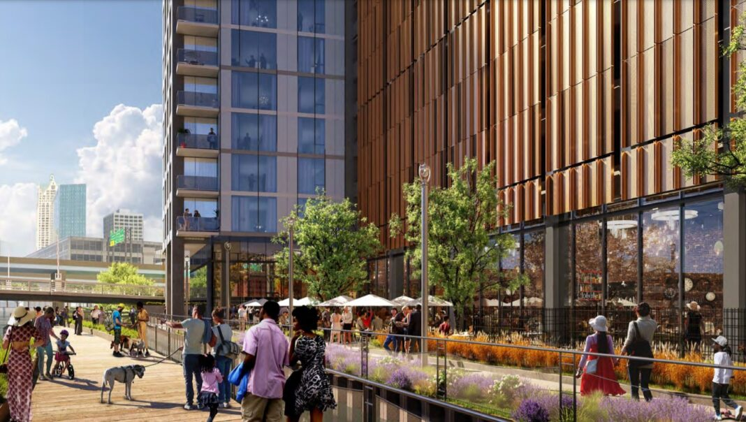 View of ground-floor retail from the Riverwalk. Rendering: Solomon Cordwell Buenz
