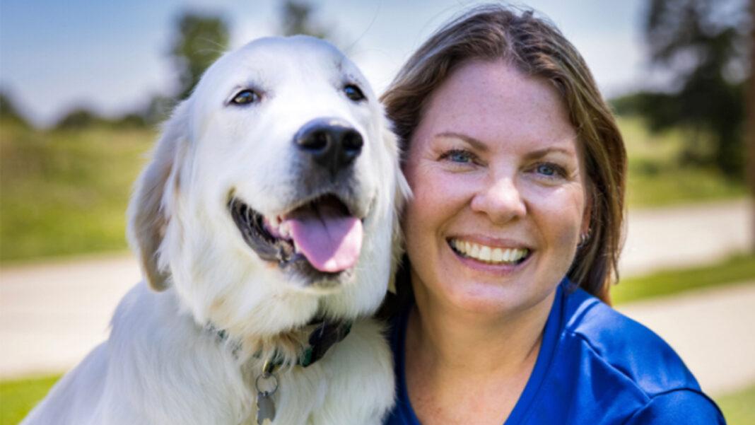 Mary Stallmann, owner of Dog Training Elite Milwaukee, and her Golden Retriever, Hank.