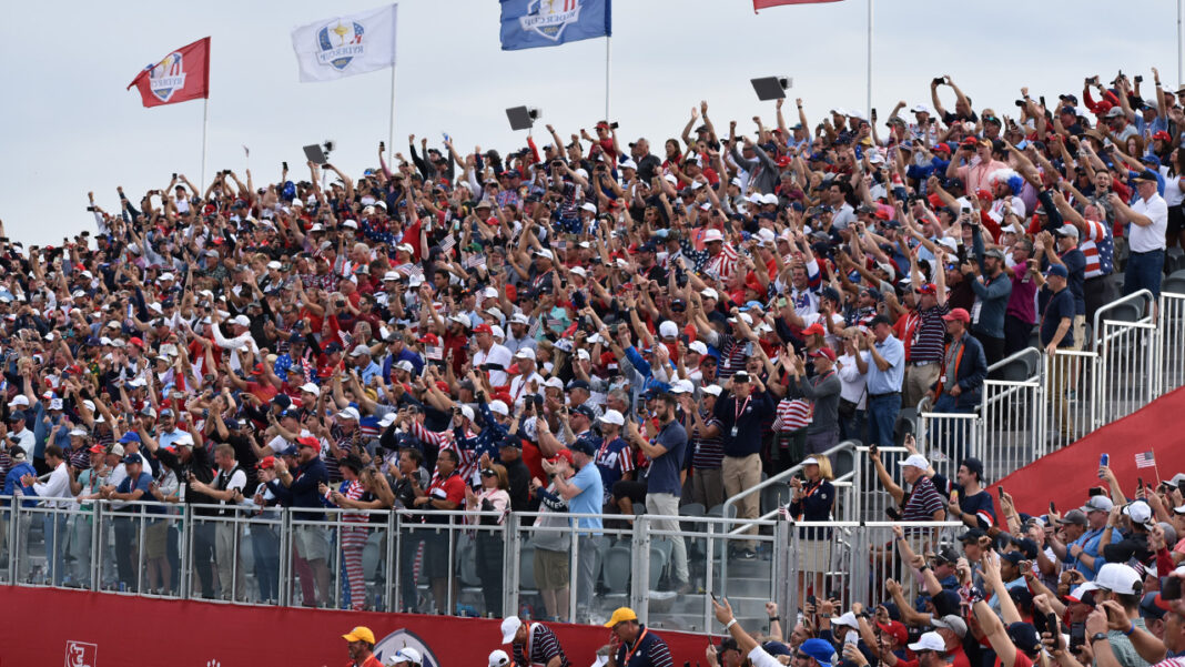 The crowd goes wild on hole 17 after Collin Morikawa sank his putt to clinch the win for Team USA.