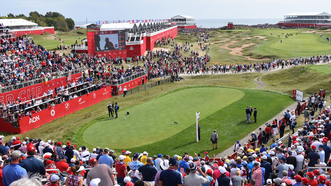 Grandstands at the 1st tee came alive before sunrise with fans eager to sit front and center.