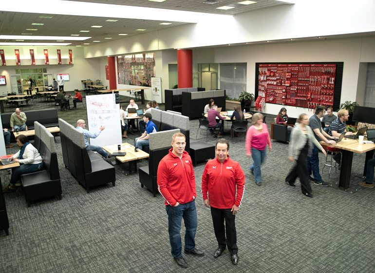 Ty Staviski, chief financial officer and Steve Richman, president of Milwaukee Electric Tool Corp. in the atrium at the company's Brookfield headquarters.