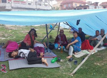 Barkha Limbu Daily's family rests under a temporary shelter in Nakhu, Nepal.
