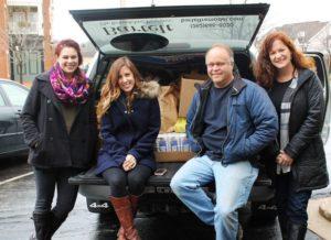 Bartelt employees Jessica Boll, Amanda Coakley, Don Mitchen and Heather Scott at the food drive.