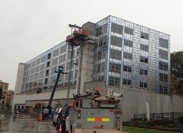 The Rhythm apartment building under construction in Milwaukee. In an annual survey of CARW members, 70.6 percent said the apartment sector is most in danger of being over-developed.