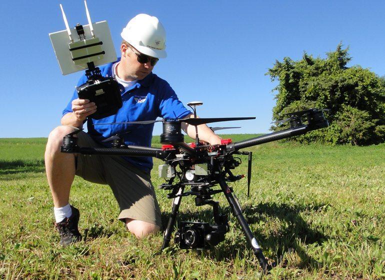 Peter Menet, founder of Menet Aero, prepares to launch his drone.