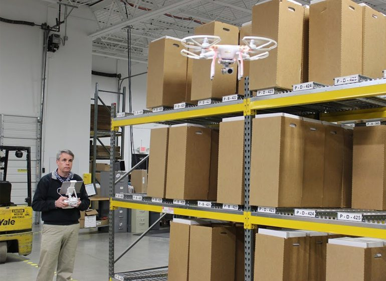 Larry Harvey, Tailored Label Products marketing and communications manager, flies his drone inside one of the company's factories.