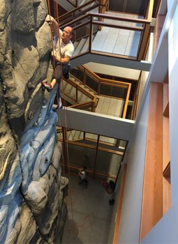 Acuity installed a climbing wall in its Sheboygan headquarters as a perk to help with employee retention.