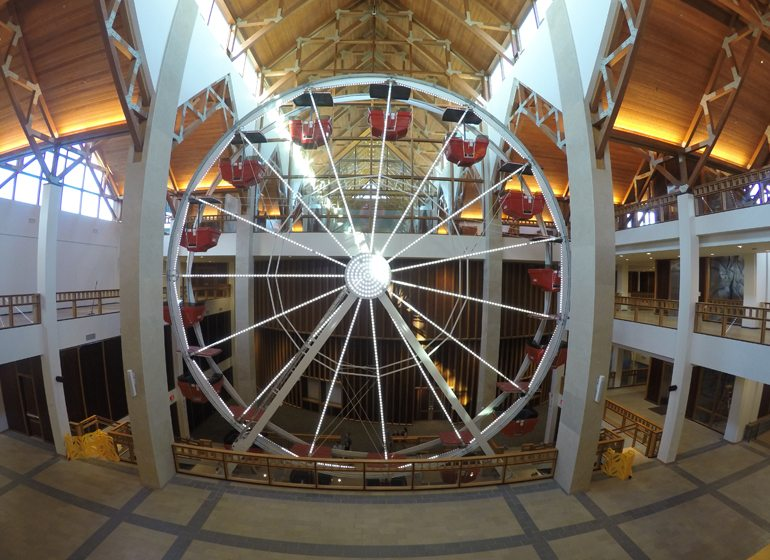 A Ferris wheel in Acutiy's headquarters serves as a memorable feature for students visiting the company and for community groups holding fundraisers.