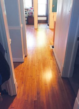 The couple refinished the home's hardwood floors with the help of contractors.