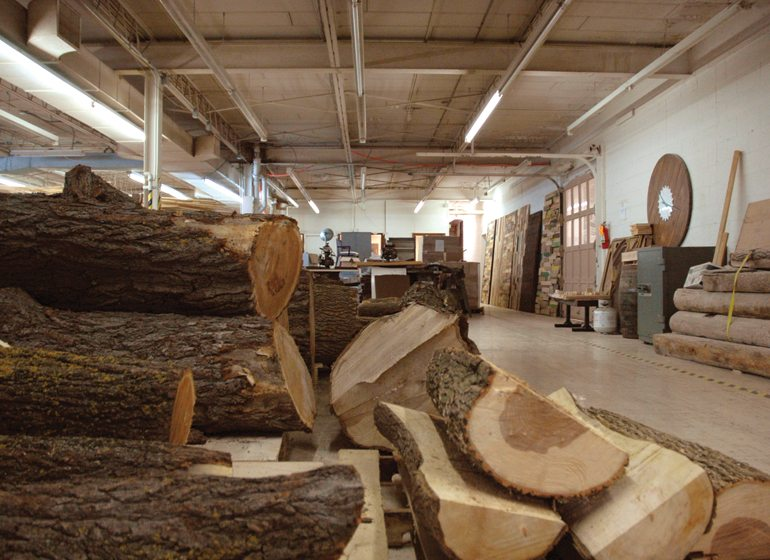 Many of Stratus Industries' projects reuse items like urban wood or logs from an 1890s cabin.