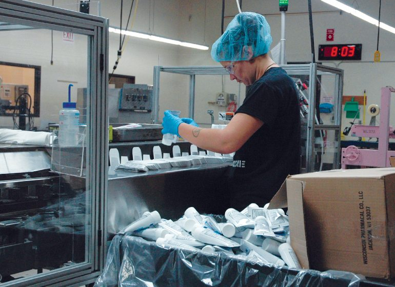 Wisconsin Pharmacal produces and packages a wide range of products using both automation and manual labor.