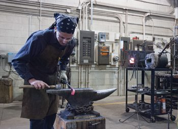 Chris Leslie works on a piece in the Scátháin metal shop.