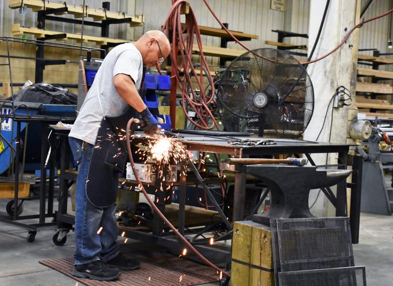Milwaukee-based Design Specialties makes custom glass fireplace doors.