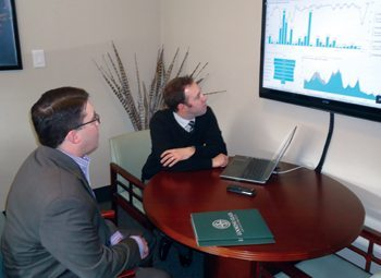 Looking Glass president and COO Matt O'Malley and CTO Brad Darnell view an analytical model.