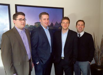 O'Malley with Looking Glass employees Andrew Siefkes, Dustin Fix and Brad Darnell.