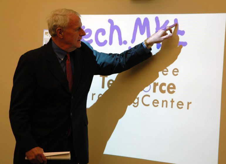 Milwaukee Mayor Tom Barrett uses a smart board to demonstrate the ease of utilizing new technologies.