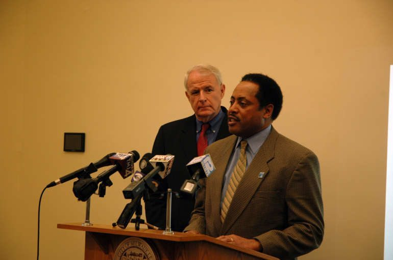 Employ Milwaukee vice president of community affairs Willie Wade speaks at a press conference Wednesday as Milwaukee Mayor Tom Barrett looks on.