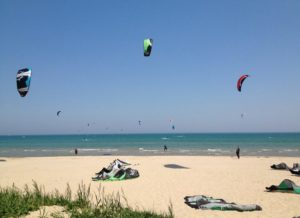 Erika and a group of her kiteboarding friends invade a beach in Sheboygan.