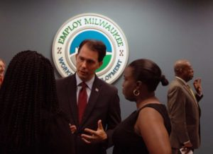 Gov. Scott Walker following a press conference at Employ Milwaukee in August.