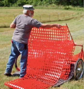 Farmer Matthew Buvala developed a special utility cart to move flexible fencing. With the help of UW-Stout's Discovery Center, Buvala has commercialized the product.