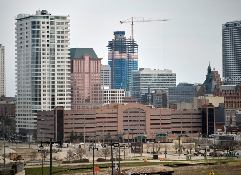 Construction of a $450 million, 32-story office tower at Northwestern Mutual's headquarters campus towers over downtown Milwaukee.