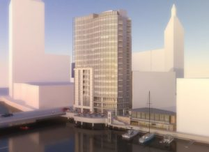 The developer plans to demolish the existing building along the Milwaukee River to make room for the tower.