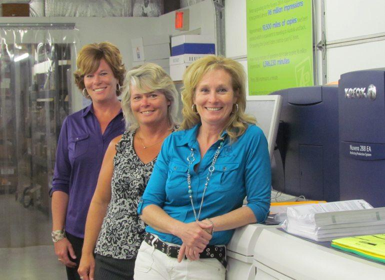(L - R) Kris Bastian, Darcy Zander-Feinauer and Beth Wenzel – fourth-generation owners