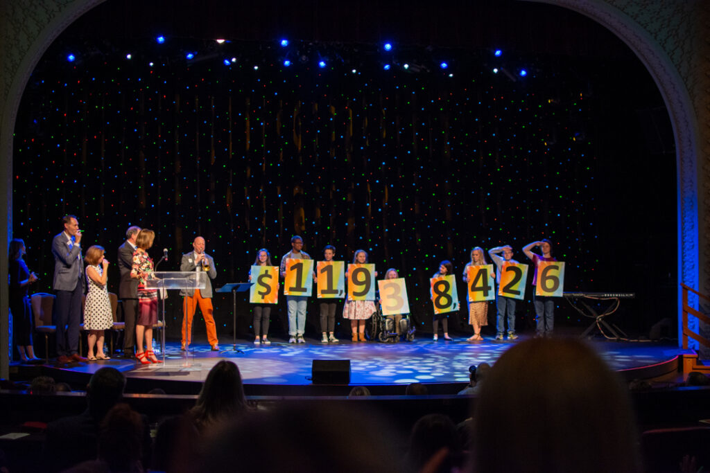 Reveal of 2019 UPAF fundraising total. (Photo: UPAF)